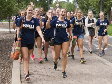Members of the NAU Swimming and Diving team wave during move-in day at Northern Arizona on Thursday, August 25, 2016, in Flagstaff, Arizona. (Joel Wolfson)