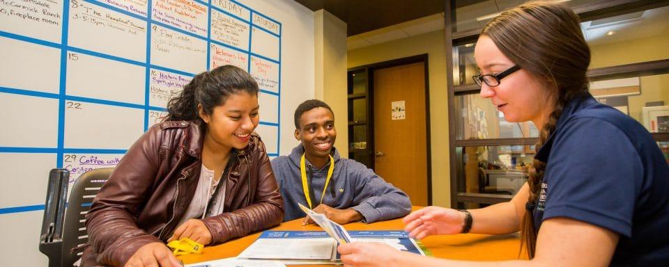 NAU incoming freshman receiving information from an advisor.