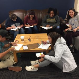 Peer Jacks Mentors with students at a workshop event in the lounge