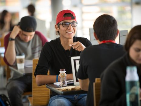 students discuss a homework assignment over lunch