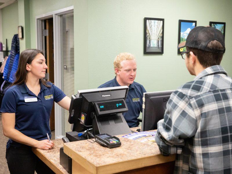 Customer at JacksCard Office Counter