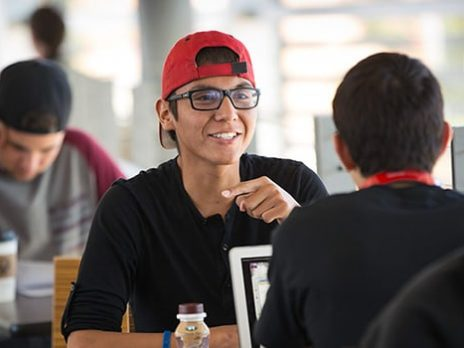 NAU student interacting with another student in Campus Dining.