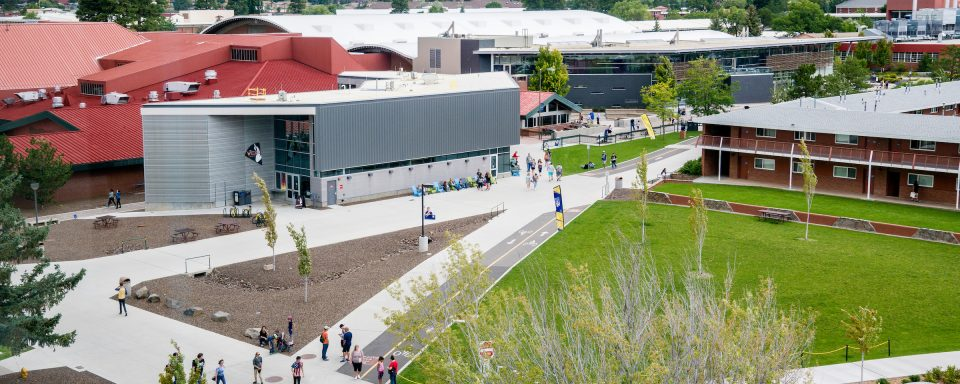 NAU students walking around Student Union in central area of campus.