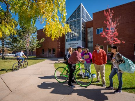 NAU students talking in a group outside the University Union.