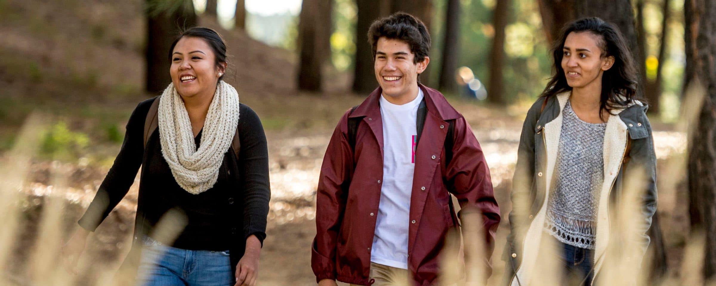 Students walking through NAU Campus.