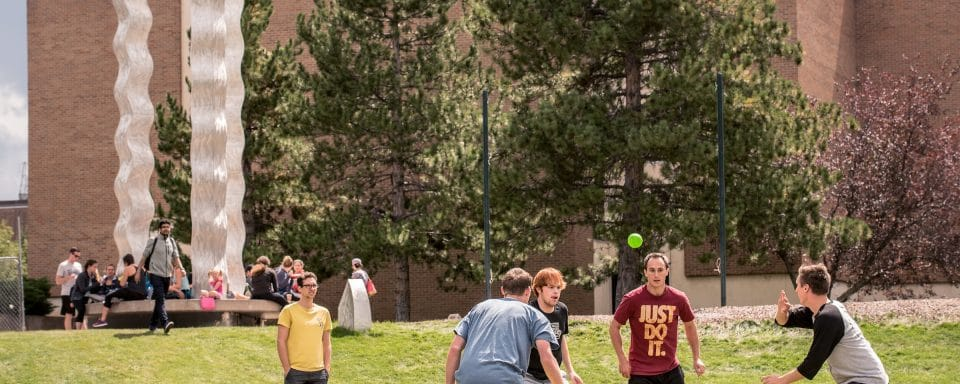 NAU students and friends playing games on campus