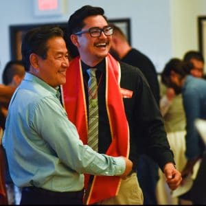 Father and son celebrate at the NAU Asian Pacific Islander Convocation