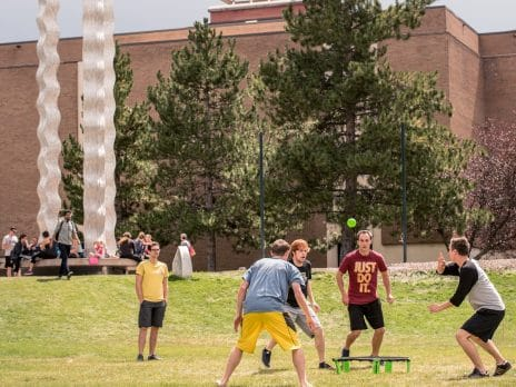 NAU student playing a game in front of du Bois center.