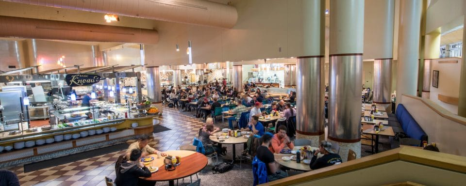 NAU student and faculty eating in dining hall.