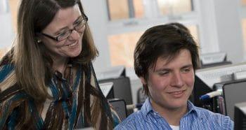 NAU representative talking with NAU student.