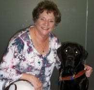 Picture of Dorianne Pollack and her guide dog Dime