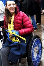 Picture of DR student who is a wheelchair user in cap and gown at her commencement ceremony