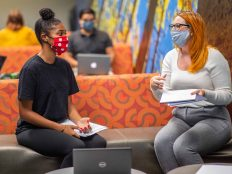 Two NAU students study together in a lounge.