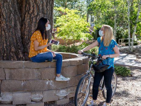 Two NAU students social distancing outside