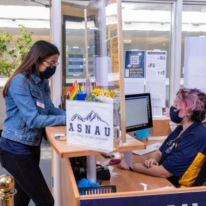 Student at front desk of the ASNAU office