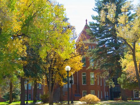 photo looking upon the north side of Old Main through the trees