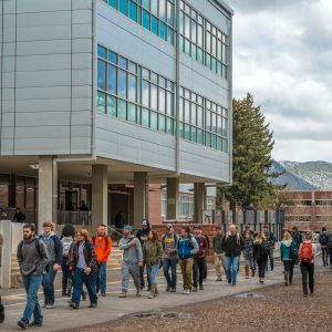 photo of a group of students walking along the pedway, past the science and health building