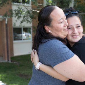 mother hugging her daughter as she is leaving for college