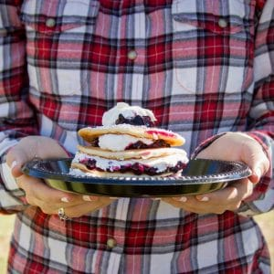 Student with plaid shirt holds Homecoming pancakes