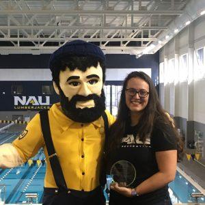 student employee holding award