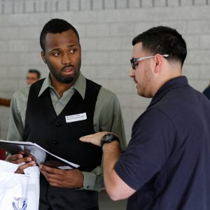Male student discusses employment options with potential employer.