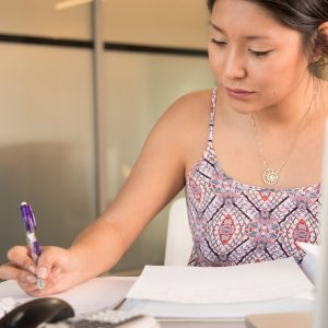 Female student concentrates on her notes.