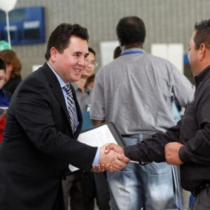 Student shaking hands with employer at the career fair