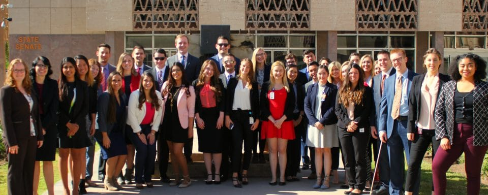 Legislative interns outside of state capitol