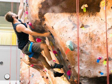 rec center climbing wall male climbing