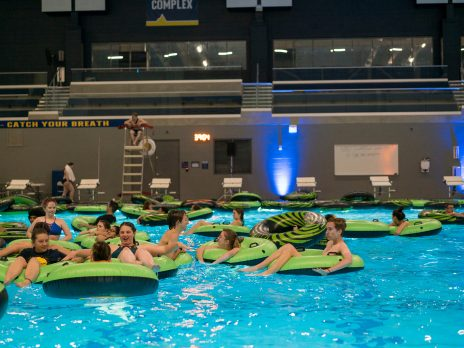 pool, WAC students inter tube floating dive in movie