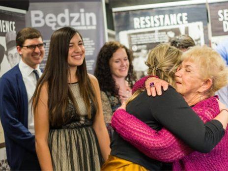 People interact at Bedzin exhibit