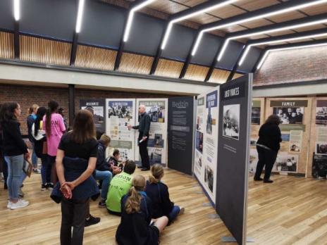 Viewers listening to Dr Krondorfer at Bedzin exhibit