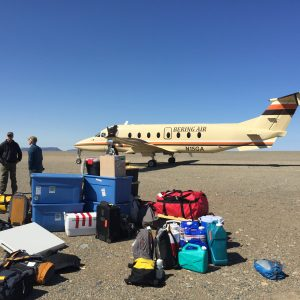Airplane, researchers, and gear in Alaska