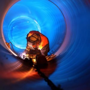 Welder welding in a confined space