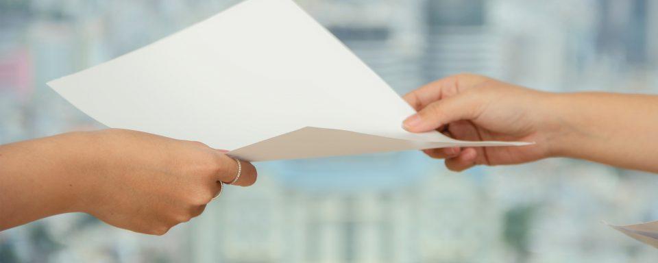 People Handing Off Paper