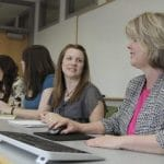 Human Resources staff talk at a conference table