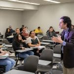 NAU faculty member lectures to a group of ethnically and gender diverse students